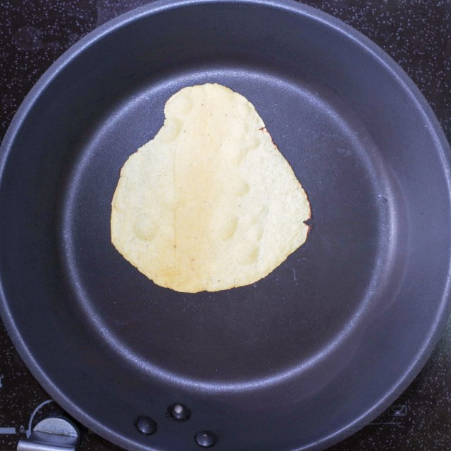 Next, heat a non stick frying pan over high heat. When surface is hot, gently peel the tortilla from the wax paper and place in the hot pan.