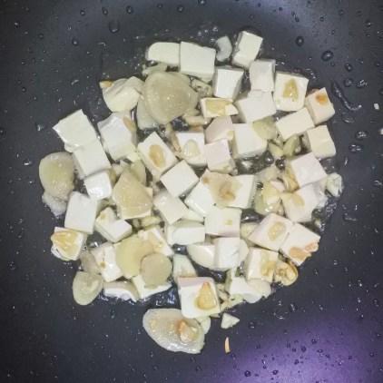 tofu, garlic and ginger frying in wok