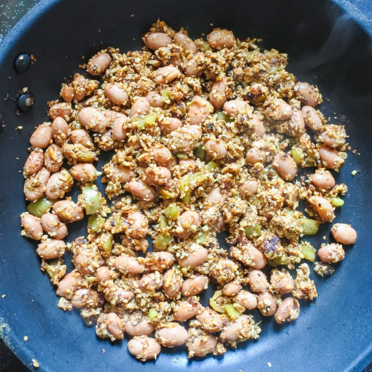 beans and minced mushrooms cooking