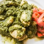 Cilantro Chicken Curry on plate with chopped tomatoes