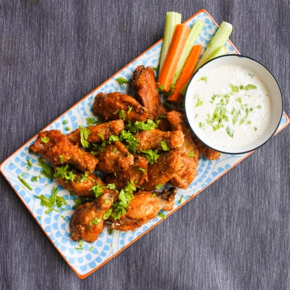 Chicken wings with carrot and celery sticks and ranch dipping sauce