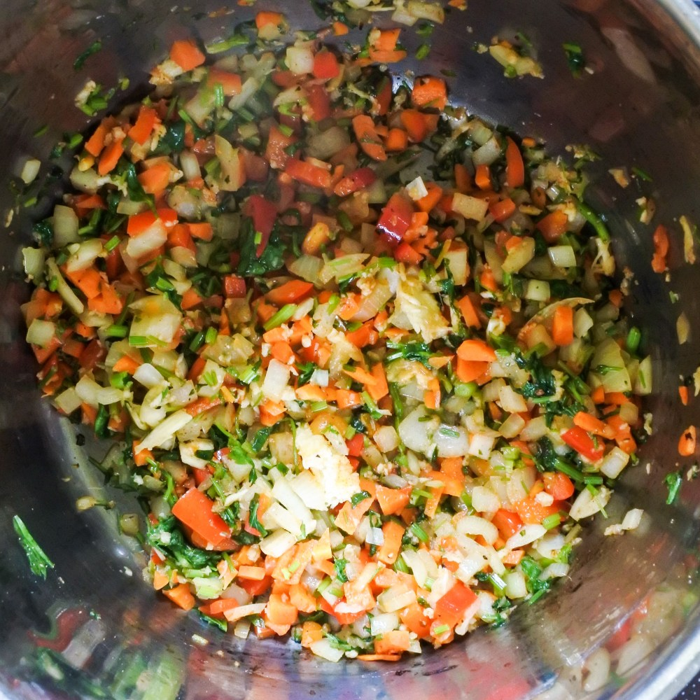 diced vegetables sauteing in pot