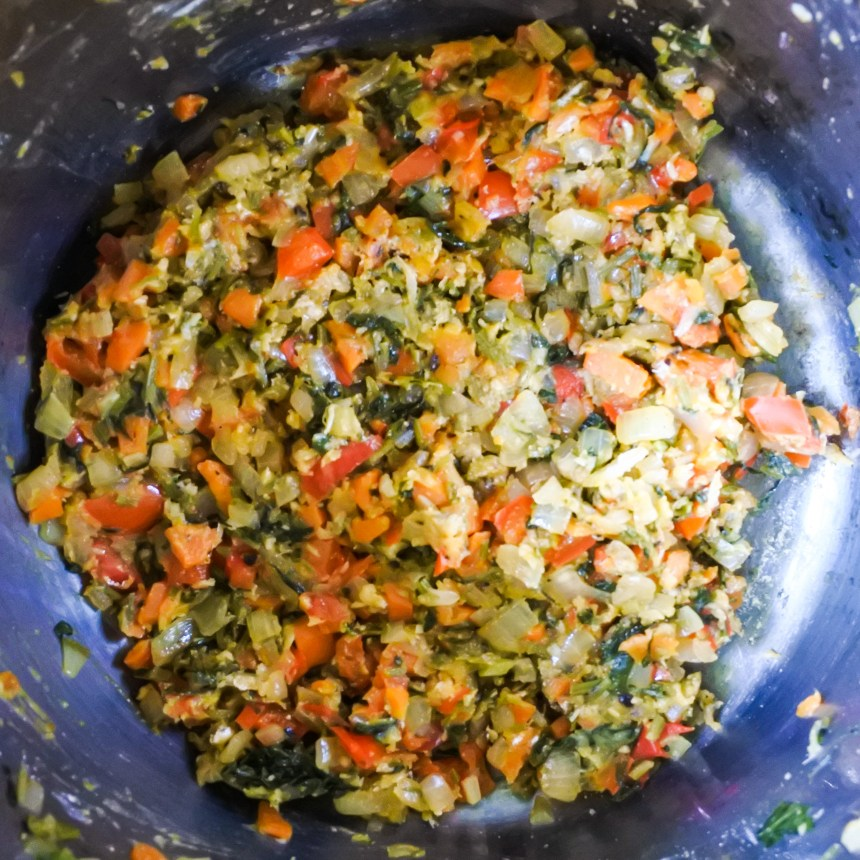 flour and vegetables cooking in pot