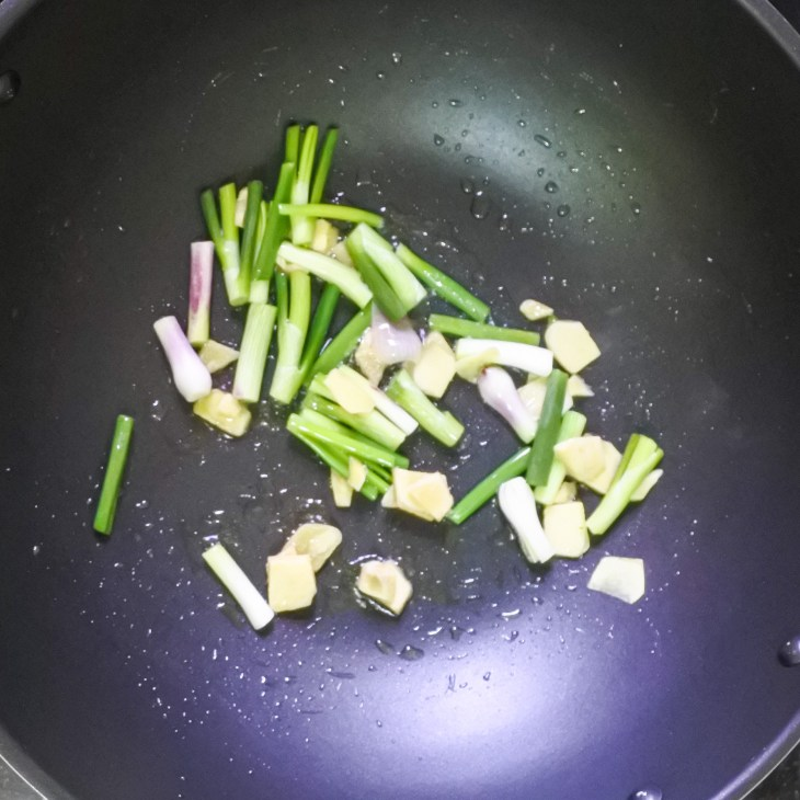 scallions and ginger frying in wok