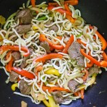 Add cold udon noodles, stir-fry for 1-2 minutes.