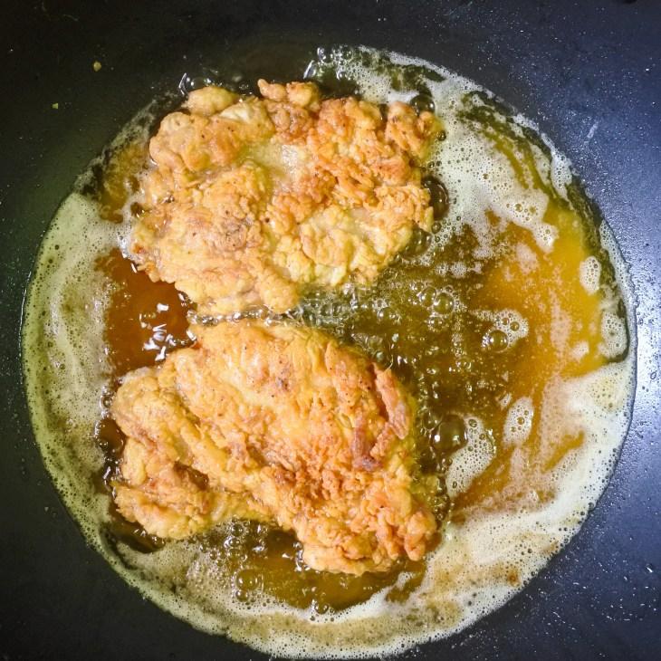 chicken frying in hot oil