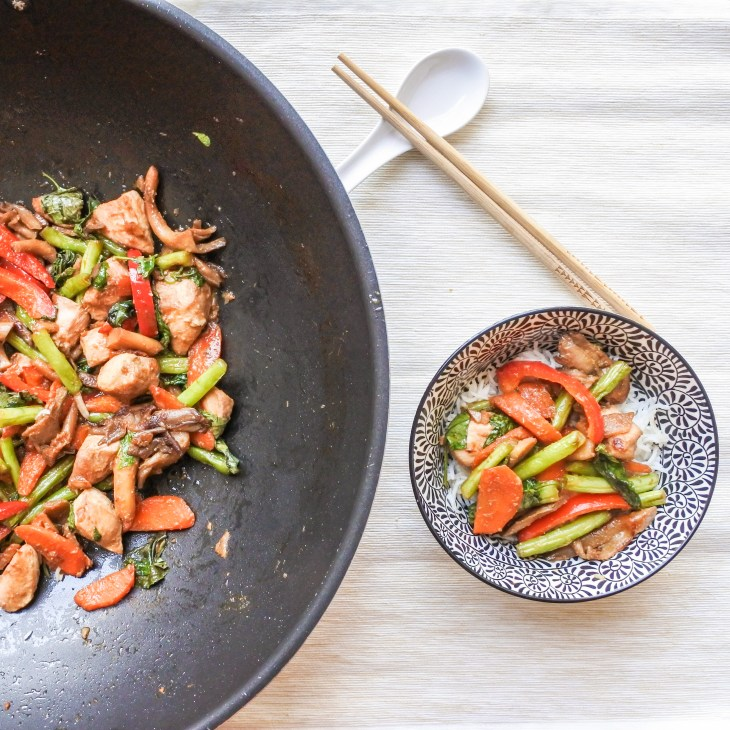 lemongrass chicken stir fry in wok and small bowl