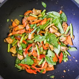 Turn off heat, add fresh Thai basil, 1 teaspoon of sugar, 1 tbsp of soy sauce and 1 tablespoon of fish sauce. Stir everything together until everything is evenly coated.