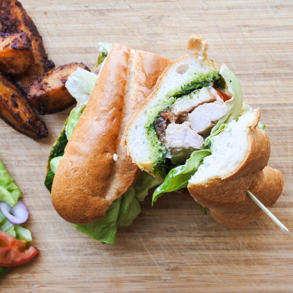 Pork Banh Mi with seasoned oven wedges on cutting board