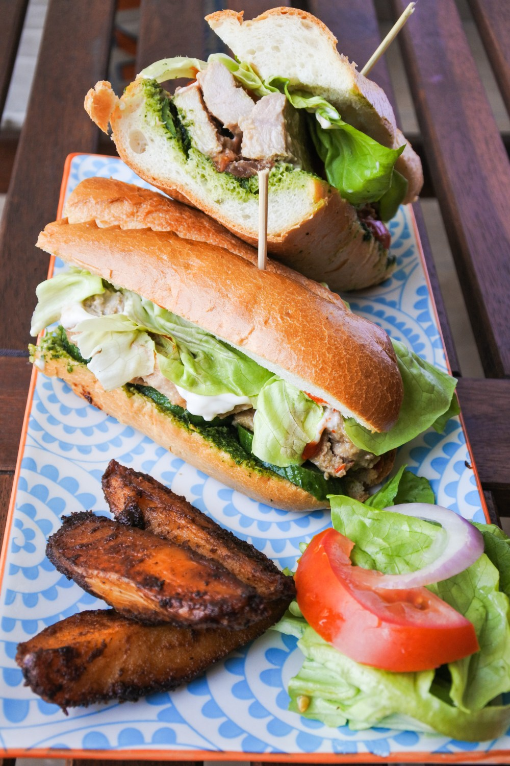 Pork Banh Mi with seasoned oven wedges and veg on plate