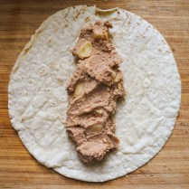 Warm tortillas in oven. When tortillas are warm and malleable, Place 1/4 cup of mixture along the center.