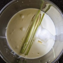 Combine heavy cream, sugar and lemongrass stalks and stir together.