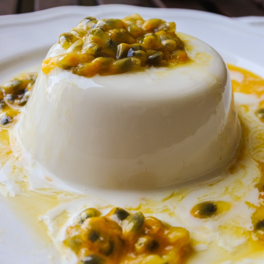 Lemongrass and Coconut Panna Cotta topped with passionfruit