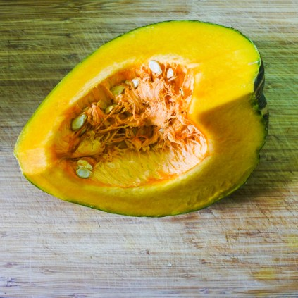 Wash and dry pumpkin. Scrape out the inside seeds and pulp with a spoon.