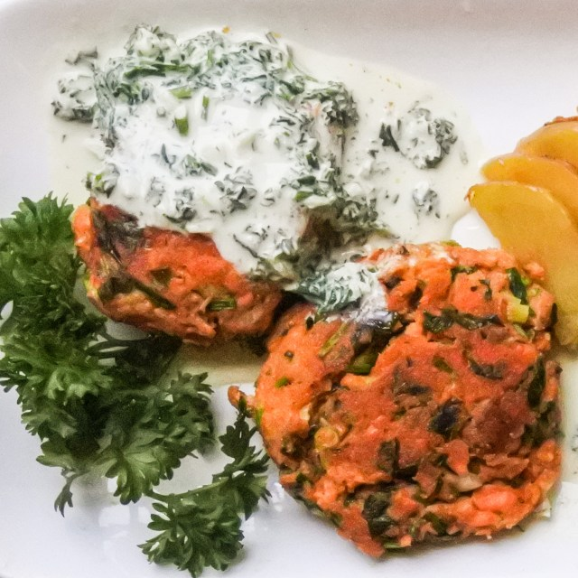 salmon cakes with parsley sauce and fried potatoes