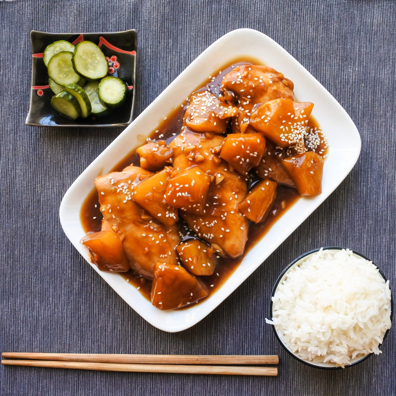 Chicken and pineapple in a soy glaze served with jasmine rice and pickled cucumber
