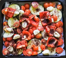 Cut raw vegetables on a roasting tray and dusted with sumac