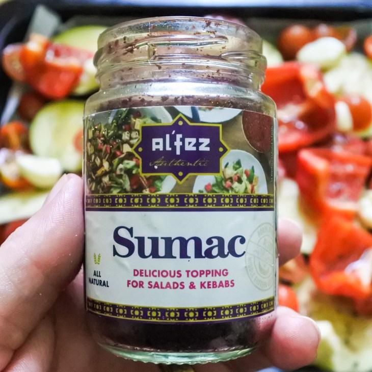 A small jar of sumac spice