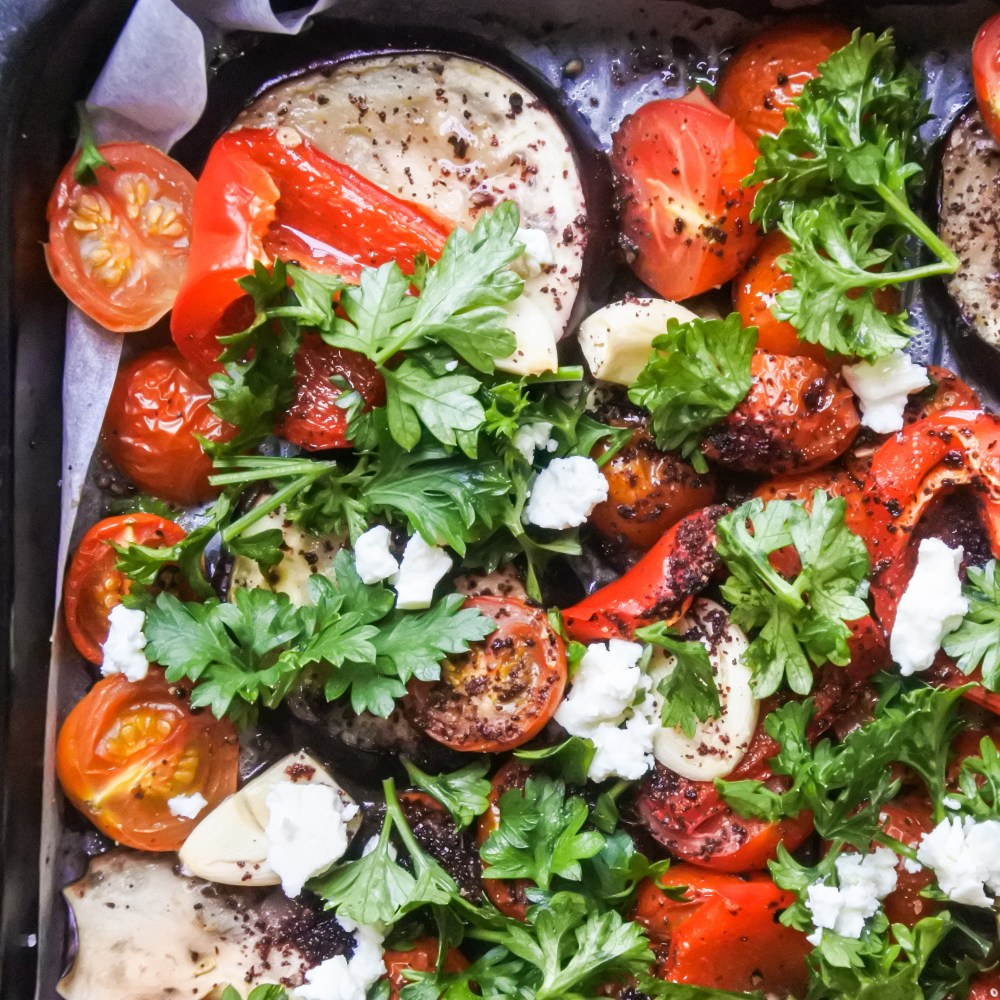 Sumac roasted vegetables garnished with feta and chopped parsley