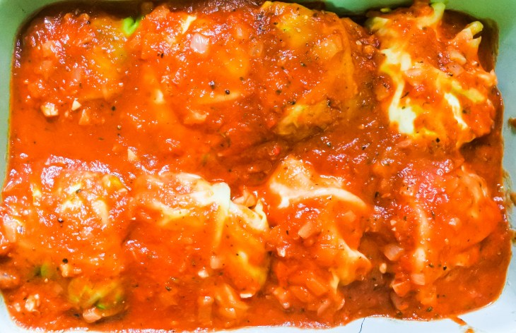 stuffed cabbage rolls covered in tomato sauce