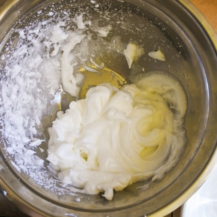 Whisk egg whites with a pinch of salt until stiff peaks have formed. When it resembles whipped cream and no liquid remains, you are done