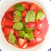 Strawberries, mint leaves and water together in a saucepan