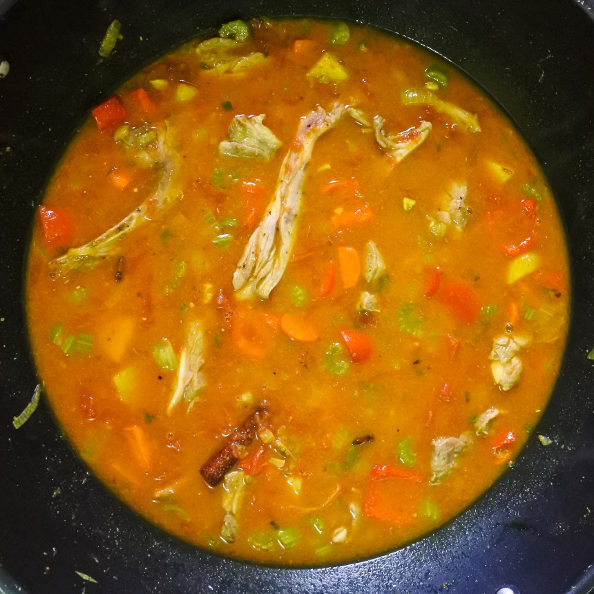 Lamb, vegetables, chicken stock and crushed tomatoes cooking together