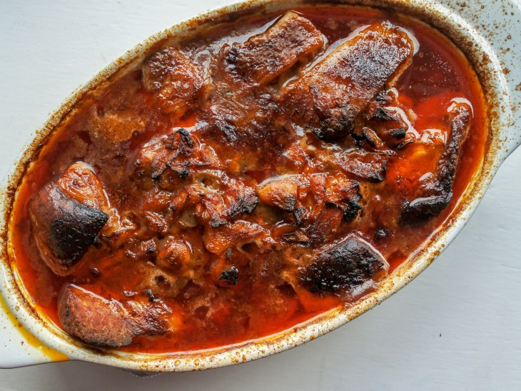 meat, ginger and garlic stewed in a chili broth in a baking dish