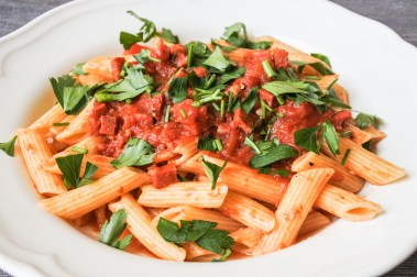 Season with salt and pepper to taste then serve.  Serve over al dente penne pasta with a  garnish of Italian parsley and grated Parmigiano-Reggiano cheese.
