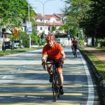 Cyclist dressed in red on Malaysian road