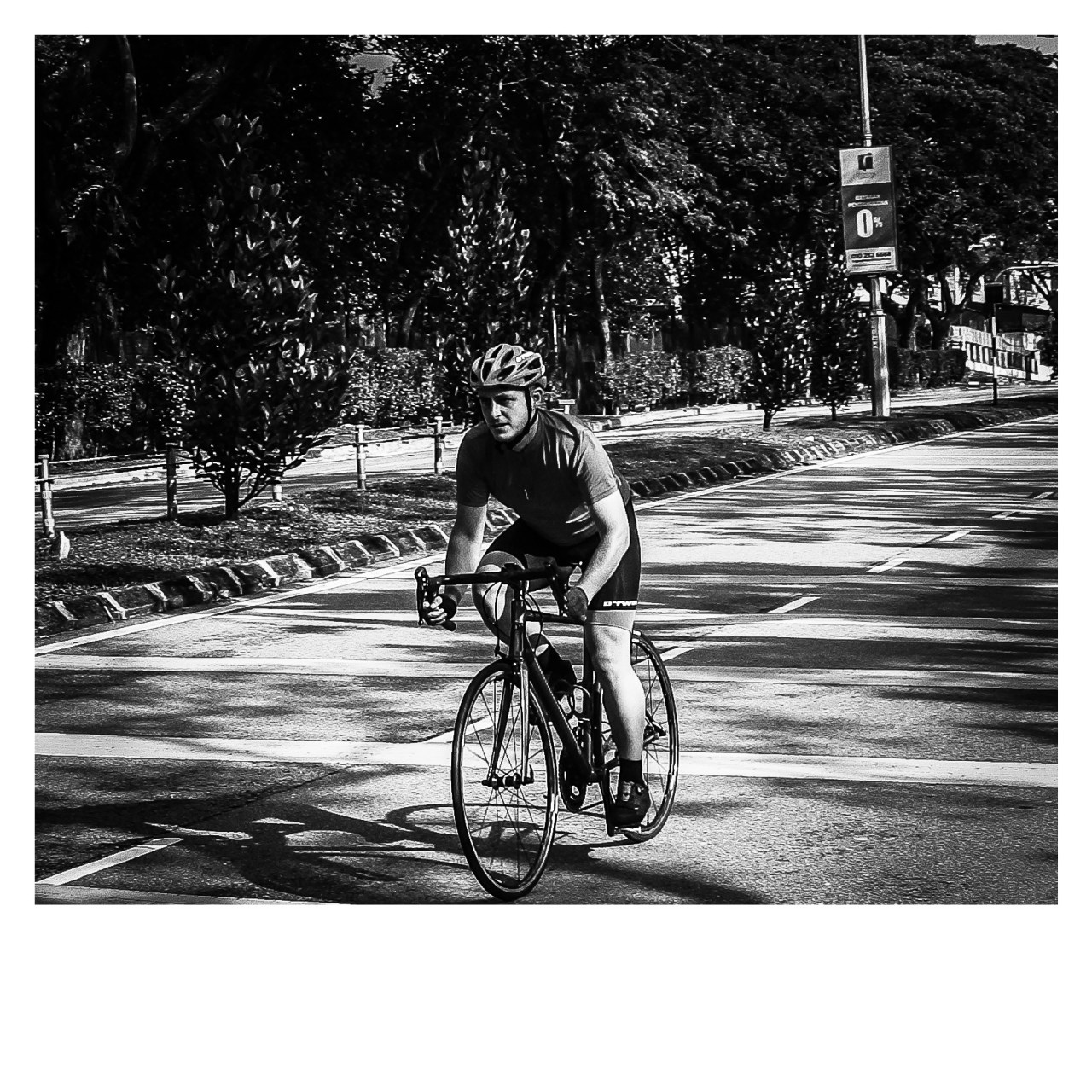 A shadowed picture of a cyclist on the road in Malaysia