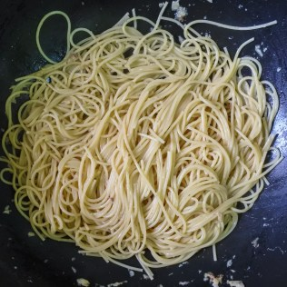 When fish is cooked, remove from pan and transfer to a plate. Drain spaghetti and toss in remaining garlic/anchovy/white wine sauce. Toss until everything is coated evenly in the sauce.