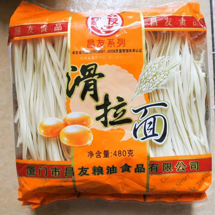 A an orange package of Chinese egg noodles