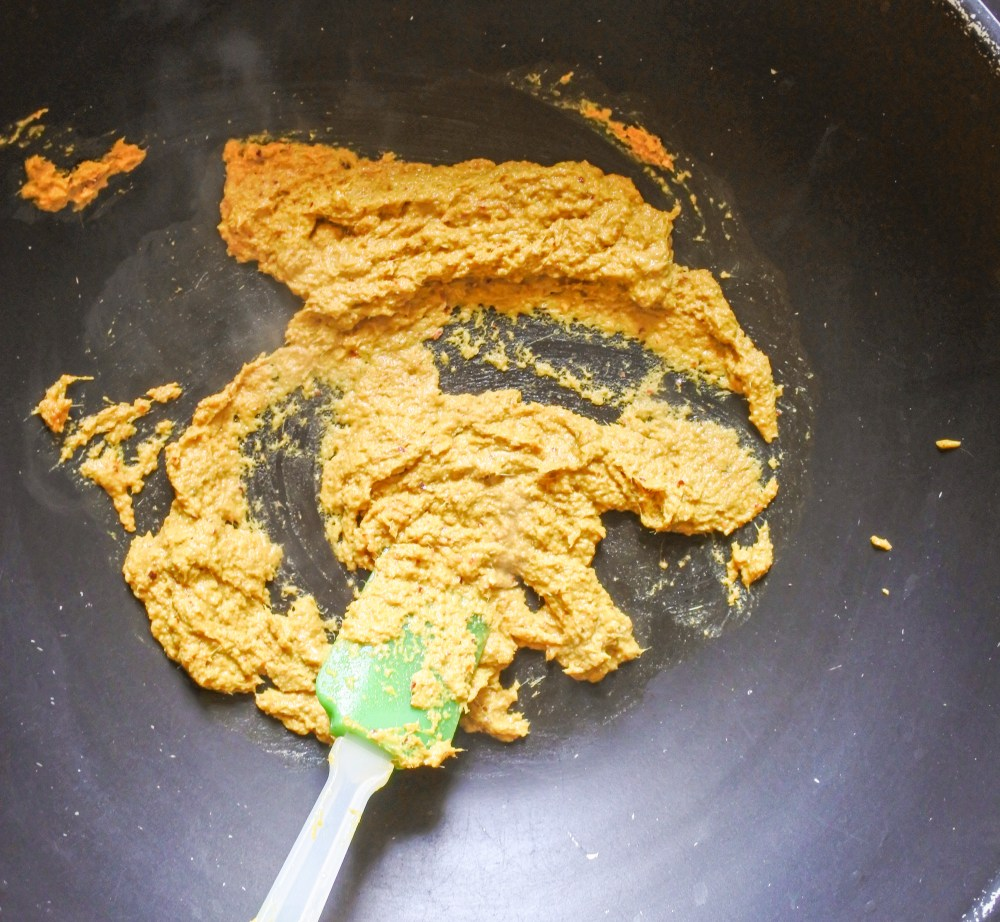 Golden curry laksa paste frying in a wok