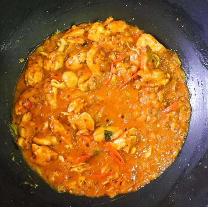 chicken simmering in balti gravy