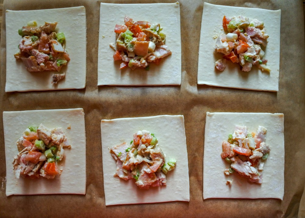 puff pastry squares with chicken, bacon and veg mixture in center