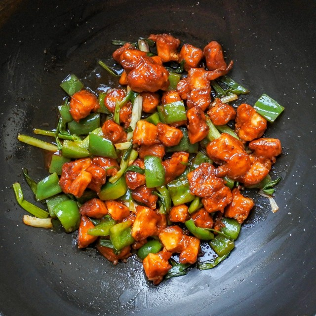 chili paneer in a wok