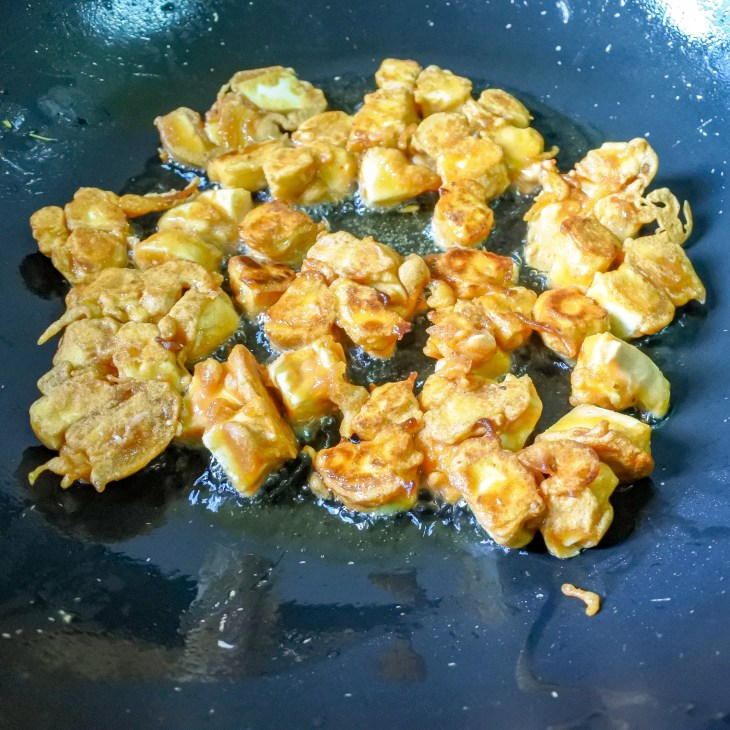 Battered paneer frying in oil