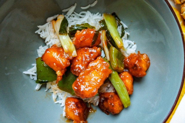 chili paneer over Basmati rice in a bowl