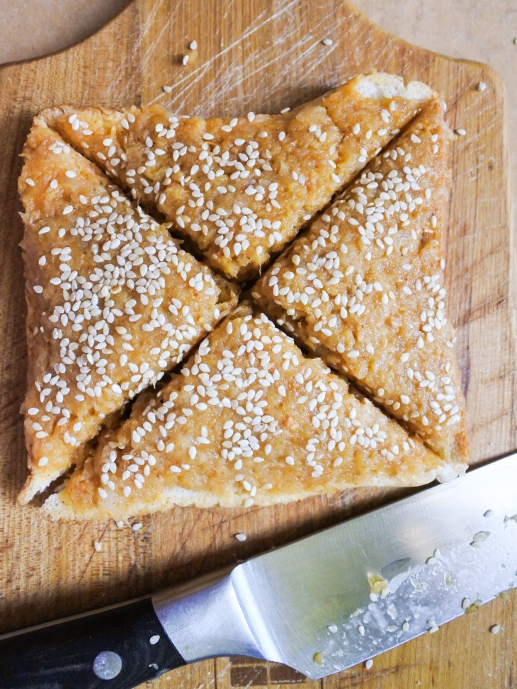 bread with curried shrimp paste and sesame seeds cut into triangles