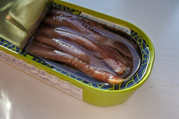 anchovies with oil in a tin