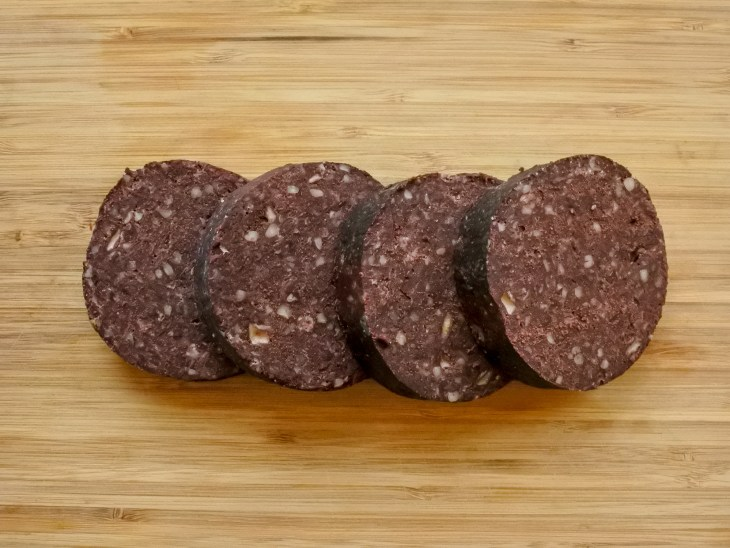 slices of black pudding on a cutting board