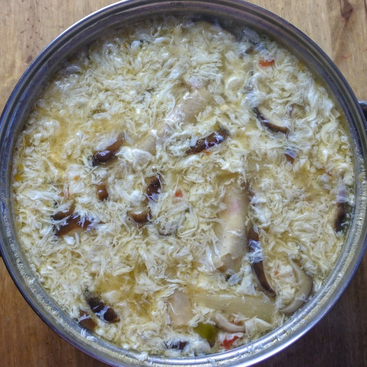 Egg drops added to Hot and Sour soup
