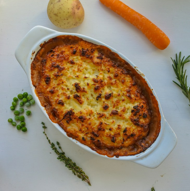 cottage pie with carrot, potato, peas, thyme and rosemary