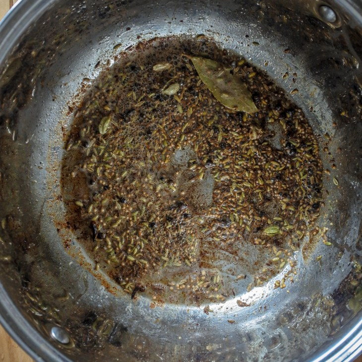 spices frying in a pan