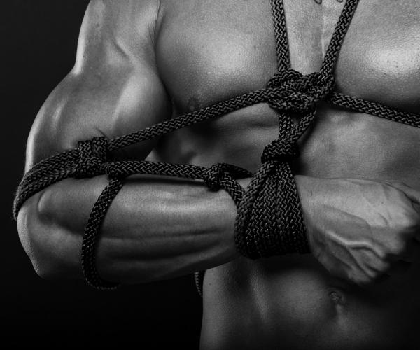 Man tied in bondage - shibari style