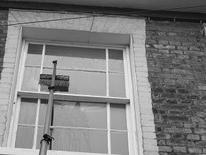 Grime removal landlord window cleaning
