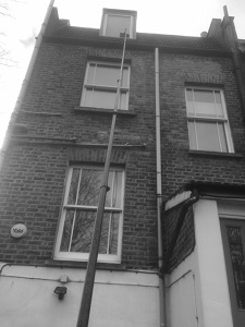 Window cleaning a three storey building with a 35ft carbon fibre pole