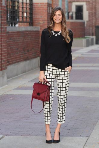 Rock the business casual look with checkered pants and a solid black top. Chunky jewelry is allowed, just don't over do it! Tie the look together with a burgundy hand purse and you're good to go.