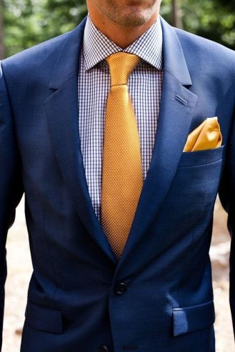 Who said suits can't be colorful? Be bold and adventurous with a checkered patterned collared shirt paired with a chic golden tie.